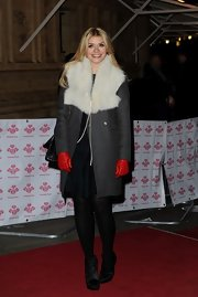 Holly Willoughby bundled up in this gray coat with fur lapels.
