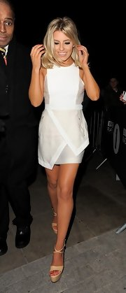 Mollie King chose this white, asymmetrical dress for her evening look at the BBC Studios.