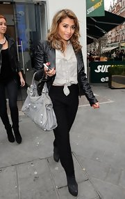 Vanessa White added just a hint of sexiness to her look by tying her classic button down at her waist.