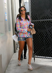 Rochelle Wiseman got colorful in a pastel plaid button down shirt.