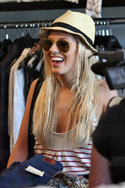 Mollie paired her classic ray ban shades with a straw fedora hat.
