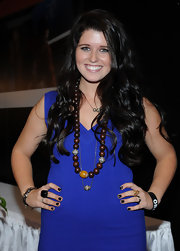 Katherine Schwarzenegger looked glamorous with long ebony curls cascading down her back.