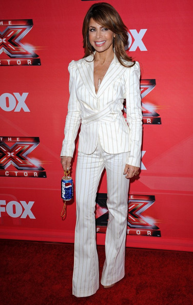 In a new form of product placement, Paula Abdul accessorized her white suit with a bedazzled Pepsi can purse.