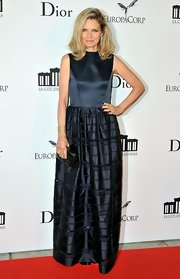 Michelle Pfeiffer chose a modest yet elegant dark teal evening dress for the opening of Cite du Cinema.