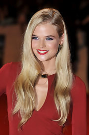 Gabriella Wilde paired amethyst eyeshadow with bold red lips at 'The Three Musketeers' premiere. The purple tones enhanced her beautiful blue eyes.