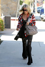 Ashley Tisdale was out and about Hollywood with a printed sweater paired with a taupe quilted leather bag complete with chain detailing.