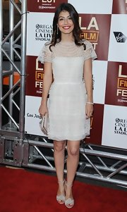 Alessandra Mastronardi looked demure and girly in a delicate white lace dress.