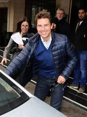 We're quite sure Tom Cruise can pull off anything, but he definitely worked this navy puffa.