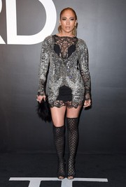 Jennifer Lopez was grunge-glam in an intricately beaded mesh-panel mini dress by Tom Ford during the label's womenswear presentation.