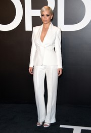 Rita Ora was at her sleekest best in a white Tom Ford pantsuit during the brand's womenswear presentation.