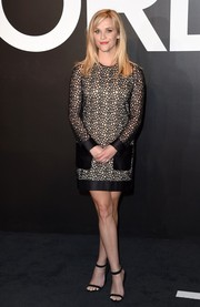Reese Witherspoon was edgy-glam in a long-sleeve, net-detailed cocktail dress by Tom Ford during the label's womenswear presentation.