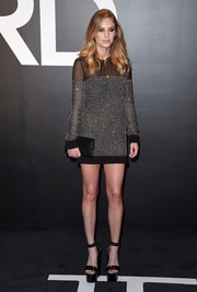 Dylan Penn teamed her dress with ultra-high black platform sandals, adding inches to her already statuesque frame.