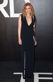 Elizabeth Olsen revealed her more daring side with this plunging, high-slit cutout gown by Tom Ford during the brand's womenswear presentation.