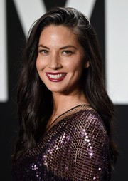 Olivia Munn left her hair down in a subtly wavy, side-parted style for the Tom Ford presentation.