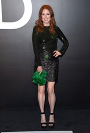 Julianne Moore added a spot of brightness with a green fur clutch.