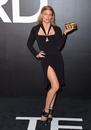 Fergie injected some shine via a metallic gold clutch.