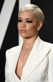Rita Ora wore a very neat side-parted 'do at the Tom Ford womenswear presentation.