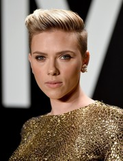 Scarlett Johansson was tomboy-chic with her side-swept fauxhawk at the Tom Ford womenswear presentation.