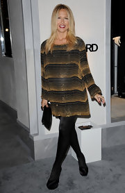 A glowing Rachel Zoe attended the Tom Ford store opening in black satin platform pumps.