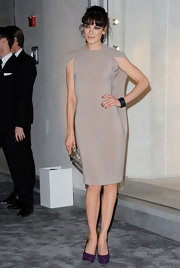Michelle Monaghan added a burst of color to her minimalist look with purple suede platform pumps.