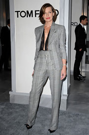 Milla looked like she stepped right off the runway in a Spring 2011 Tom Ford suit at the opening of his new store in Beverly Hills.