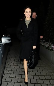 Olga Kurylenko chose a black wool coat for her bundled up look while out in London.