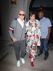 Kris Jenner was all abloom in a Dolce & Gabbana floral robe while enjoying a night out at Craig's.