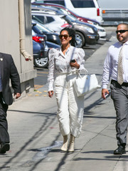 Cream lace-up boots completed Tracee Ellis Ross' outfit.