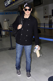 Michael Buble traveled in a navy blue pea coat.