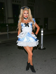 Paris Hilton came as a sexy Alice in this blue and white mini dress by Trashy at the treats! Magazine Halloween party.