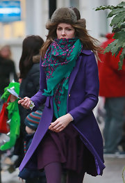 Trinny Woodall topped off her colorful school run ensemble with a green and purple scarf.