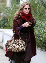 Trinny Woodall complemented her monochromatic outfit with a leopard-print tote as she took her daughter to school.