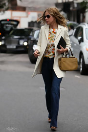Trinny Woodall looked fashionable in a white blazer, print blouse, and jeans as she ran errands in Notting Hill.