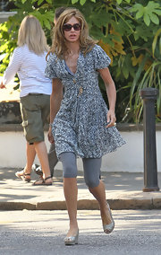 Trinny Woodall looked easy-breezy in a black-and-white print dress and gray leggings while on the school run.
