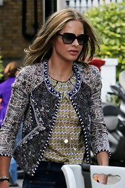Trinny Woodall topped off her chic ensemble with a pair of oversized sunnies.