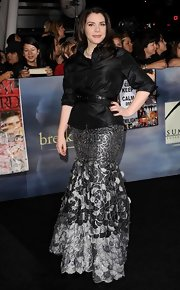 Stephenie Meyer accentuated her curvaceous figure in a shiny belted blouse.