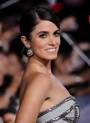"Nikki Reed's 14k diamond earrings dazzled at the world premiere of 'The Twilight Saga: Breaking Dawn - Part 2"" premiere."