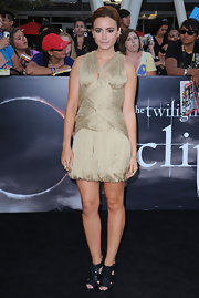 Lily paired her wrapped cocktail dress with leather gladiator heels.