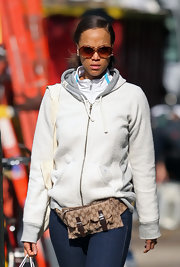 Tyra's stroll around NYC would not be complete with out her Gucci bag and oversized shades.
