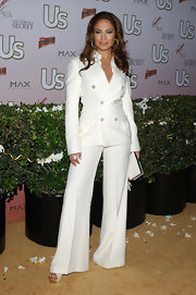 Jennifer Lopez hit the US Hot Hollywood party in a white wide-legged pantsuit.