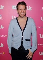 Perez Hilton showed a bit of skin in a deep-V gray cardigan during the US Weekly Hot Hollywood event.