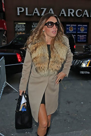 Rachel Uchitel carried a classic black leather tote while out in NYC. The tote was brimming over with Rachel's things.