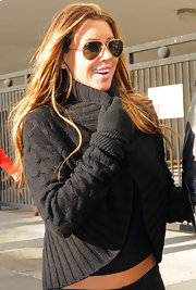 Tiger Woods' former mistress Rachel Uchitel dons a pair of classic Ray Ban sunglasses.