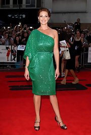 Katherine dazzles in a sparkling green one shoulder dress with a tie belt. She looks like a lovely mermaid.