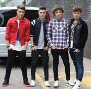 Josh Cuthbert chose a bright red denim jacket while out at the London Studios.