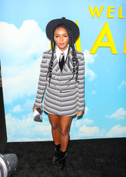 Janelle Monae styled her suit with black patent ankle boots.