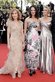 Isabelle Huppert was a stunning standout at the 'Up' premiere in an embellished nude evening dress by Armani Prive.