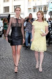 Kathy Hilton looked demure and classy at the Valentino show in a yellow lace cocktail dress.