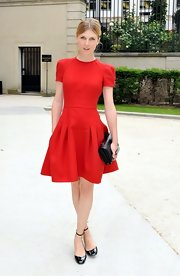 We are madly in love with Clemence's red fit-and-flare dress! Perfection personified.