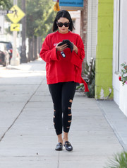 Vanessa Hudgens pulled her look together with a pair of black Gucci Princetown slippers.